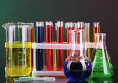 Colorful test tubes on dark background — 图库照片