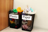 Buckets for waste sorting on room background — Stockfoto