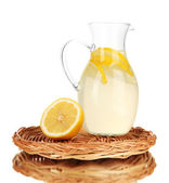 Lemonade in pitcher isolated on white — Stock Photo