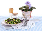Light salad on plate on napkin on table — Stockfoto