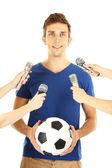 Intervista con un giovane calciatore, isolato su bianco — Foto Stock