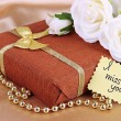 Romantic parcel on gold cloth background — Foto Stock