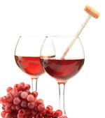 Glasses of wine with thermometer and grape, isolated on white — Stock Photo