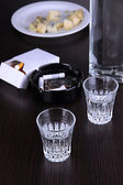 Vodka and snack on table close-up — Stok fotoğraf