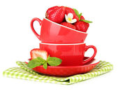 Ripe sweet strawberries in red cups, isolated on white — Stock Photo