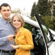 Portrait of happy beautiful couple with car keys, standing near the car — Stock Photo