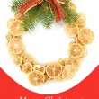 Christmas wreath of dried lemons with fir tree and bow — Stock Photo