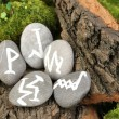 Stock Photo: Fortune telling with symbols on stone close up