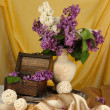 Composition with lilacs on bright background — Stock Photo #26324639