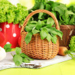 Stock Photo: Fresh herb in basket on wooden table on natural background