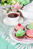 Delicious beautiful cupcakes on dining table close-up — Stock Photo