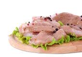 Carne di pollo a bordo isolato su bianco — Foto Stock