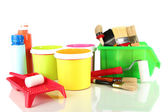 Paint pots, paintbrushes and coloured swatches isolated on white — Stock Photo