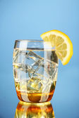 Glass of water and ice on blue background — Foto de Stock