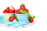 Ripe sweet strawberries in bowls, isolated on white — Stock Photo