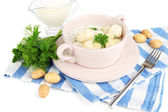 Tender young potatoes with sour cream and herbs in pan isolated on white — Stock Photo
