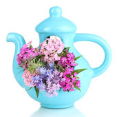 Beautiful bouquet in blue teapot isolated on white — Stock Photo