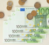 Euro banknotes and euro cents isolated on white — Stock Photo