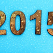 2015 in golden numbers, on blue background — Stock Photo