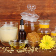 Fragrant honey spa with oils and honey on wooden table on wooden background — Stock Photo