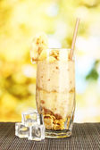 Delicious fruit smoothie on bright background — Stock Photo