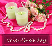 Candle on pink fabric close -up — Stock Photo