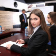 Portrait of young businesswoman in business training with her colleagues — Stock Photo