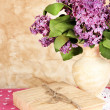 Composition with lilacs on beige background — Stock Photo #26380793