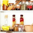 Variety spices on kitchen shelves — Stock Photo #26385785