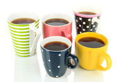 Many cups of coffee isolated on white — Stock Photo