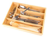 Wooden cutlery box with checked cutlery isolated on white — Stock Photo