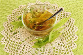 Glass cup of tea with linden on napkin close-up — Stock Photo