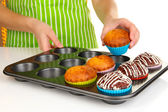 Preparing tasty muffin cakes close up — Stock Photo