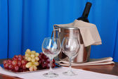 Wine and glasses on round table on cloth background — Stock Photo
