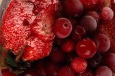 Frozen berries in bucket of ice close-up background — Stock Photo