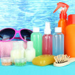 Stock Photo: Hotel cosmetics kit on bright color background