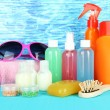 图库照片: Hotel cosmetics kit on bright color background