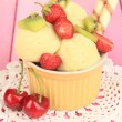Delicious ice cream with fruits and berries in bowl on wooden table — Stock Photo #26426325