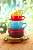 Mountain colorful dishes on nature background — Stock Photo