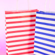 Stock Photo: Stripped bags on light pink background