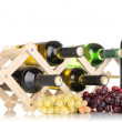 Stock Photo: Bottles of wine placed on wooden stand isolated on white