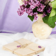 Composition with lilacs on light fabric background — Stock Photo #26434707
