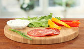 Ingredients for preparing salami rolls, on bright background — Stock Photo