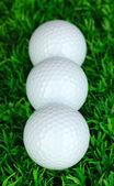 Golf balls on grass close up — Stock Photo