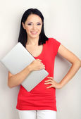 Beautiful young woman with notebook in room — Stock Photo