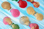 Colorful seashells on color wooden background — Stock Photo