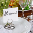 Table setting with chamomiles on wooden table close-up — Stock Photo #26491365