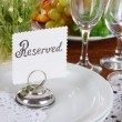 Table setting with chamomiles on wooden table close-up — Stock Photo