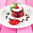 Tasty jelly dessert with fresh berries, on color wooden background — Стоковая фотография
