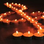 Burning candles as treble clef on dark background — Stock Photo #26492751